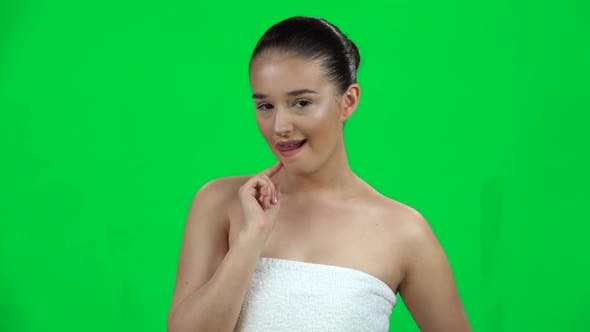 Thumbnail for Lovely Girl Coquettishly Smiling, Showing Tongue and Wink , Green Screen. Slow Motion