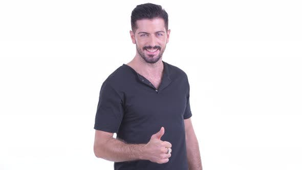 Thumbnail for Happy Young Handsome Bearded Man Giving Thumbs Up