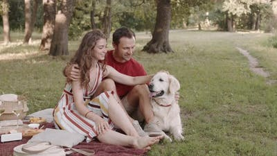 Couple with Dog on Picnic