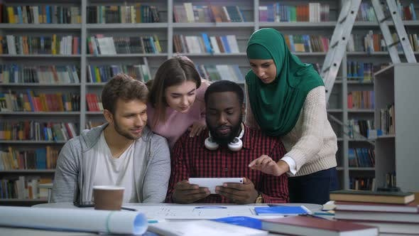 Thumbnail for Students with Tablet Pc Researching in Library