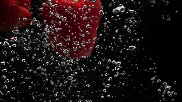 Thumbnail for Fresh Bell Peppers Falling Into Water with Air Bubbles in