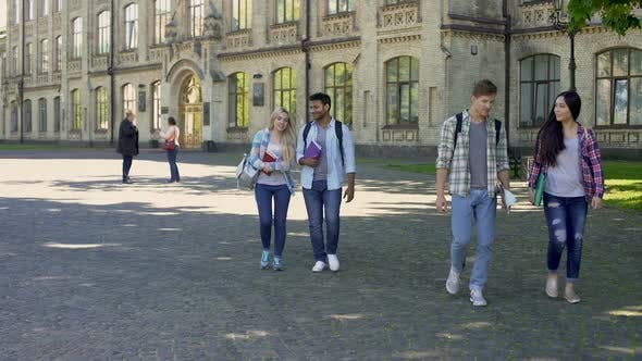 Thumbnail for Mixed-Race Couples of Students Walking at University Courtyard After Classes