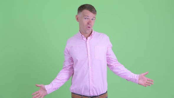 Cover Image for Portrait of Confused Businessman Shrugging Shoulders