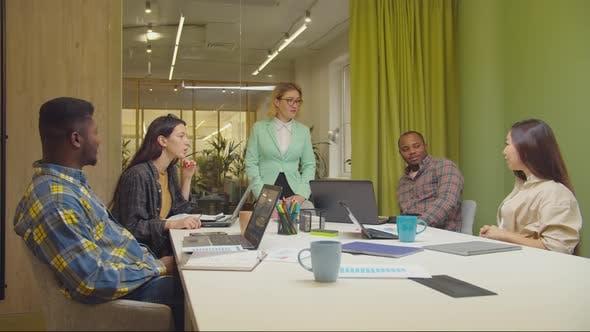Multicultural Business Team Brainstorming in Boardroom