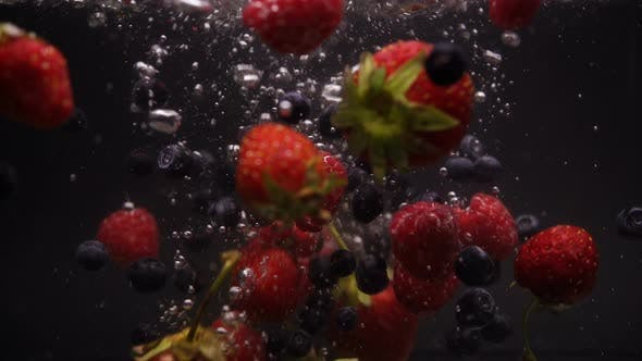 Thumbnail for Strawberries, Blueberries, Raspberries Washes In Flowing Water