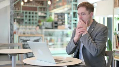Young Man with Laptop Having Loss Failure