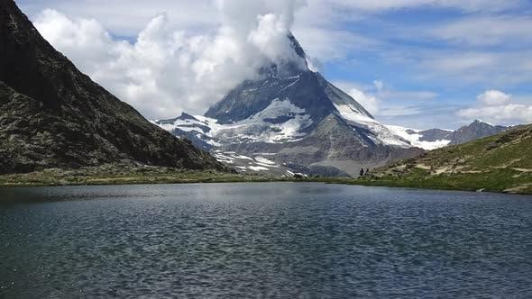 Time-lapse snowy Matterhorn peak and lake Stellisee, Swiss Alps, Zermatt
