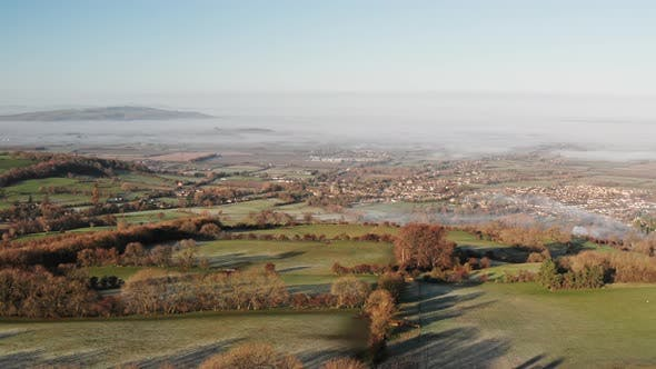 Aerial drone view of The Cotswolds Hills with Broadway in the valley, with beautiful rural countrysi