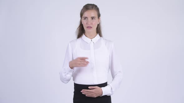 Thumbnail for Young Happy Pregnant Businesswoman Thinking and Pointing Up