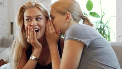 Two Girls Are Gossiping