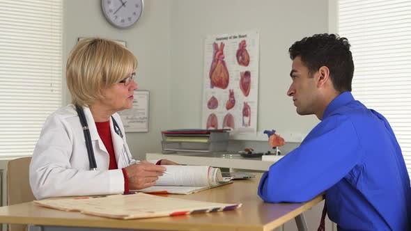Thumbnail for Side view of doctor and patient talking