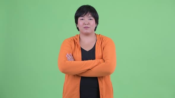 Thumbnail for Happy Young Overweight Asian Woman Smiling with Arms Crossed Ready for Gym