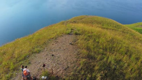 Aerial: couple tourists hiking on Lake Toba Sumatra Indonesia
