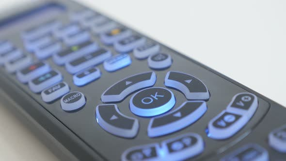 Thumbnail for Buttons lighted on multimedia device remote control 4K video