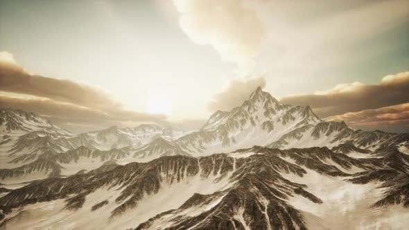 Cover Image for Panorama of High Snow Mountains at Sunset
