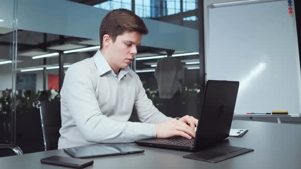 Financial Analyst Preparing Report Before Deadline