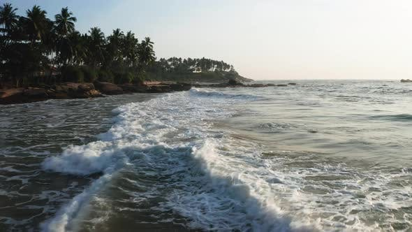 Thumbnail for Ocean Waves on a Sandy Beach During Sunrise. View of the Beach, Ocean and Palm Trees. Sri Lanka