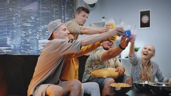 Thumbnail for Attractive Boys and Girls Cheers with Each Other with Dry Ice Cocktails