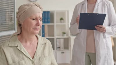 Woman with Oncology Crying at Doctor Office