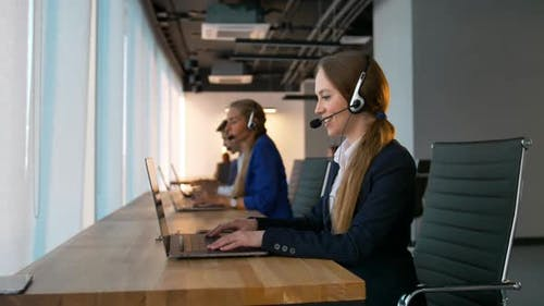 Pretty Confident Call-center Female Consultant Have Deal with Customers