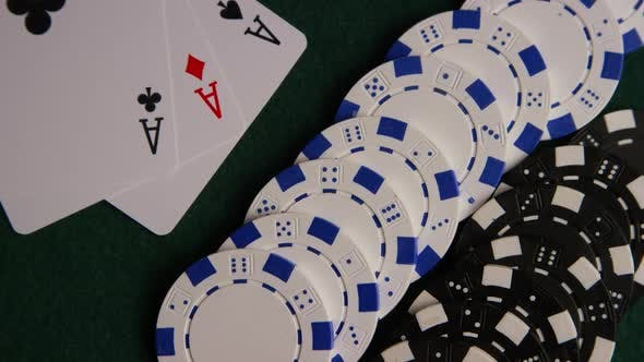 Thumbnail for Rotating shot of poker cards and poker chips on a green felt surface - POKER 061