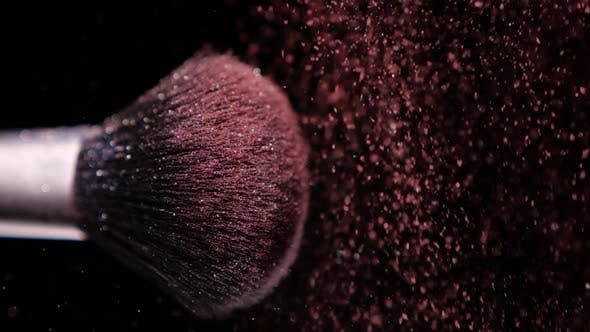 Thumbnail for Make Up Brush with Colored Red Powderon at Black Background Slow Motion