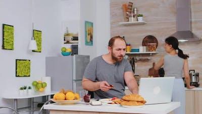 Stressed Entrepreneur Working on Laptop