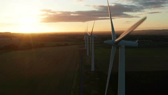 Thumbnail for Four wind turbines at sunrise