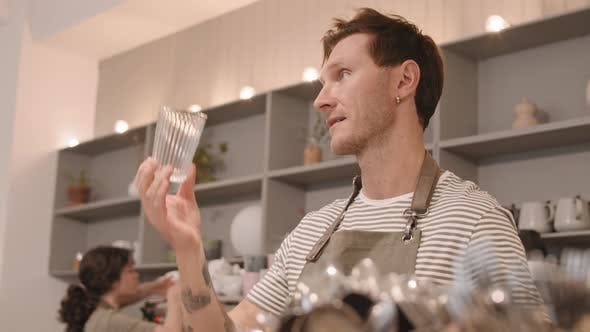 Thumbnail for Male Barista Wiping Glasses behind Counter