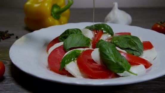 Thumbnail for Caprese Salad With Pouring Olive Oil 04b