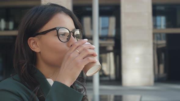 Elegant Businesswoman on Coffee Break