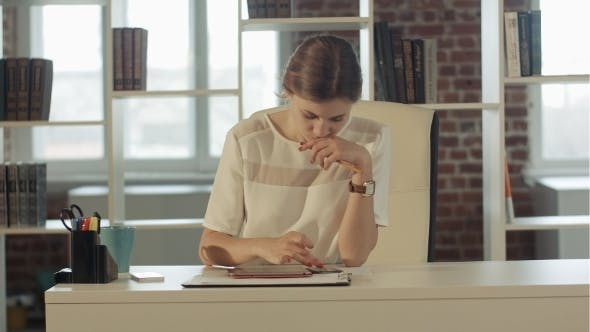 Thumbnail for Businesswoman In The Office At The Table Working