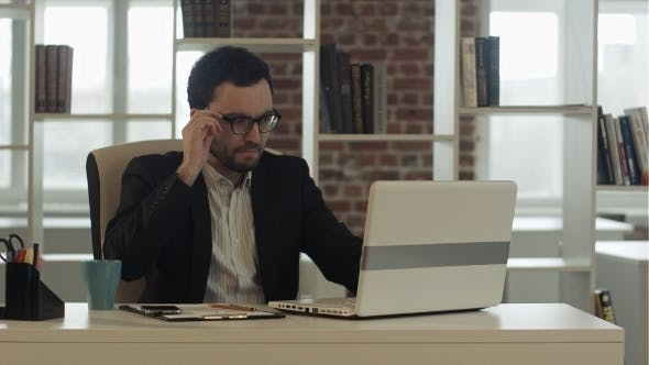 Thumbnail for Businessman In Funny Glasses Typing On Keyboard