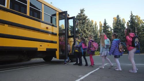 Elementary Age Students Entering School Bus