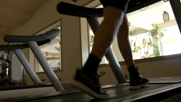 Thumbnail for Stepping On Treadmill In The Gym