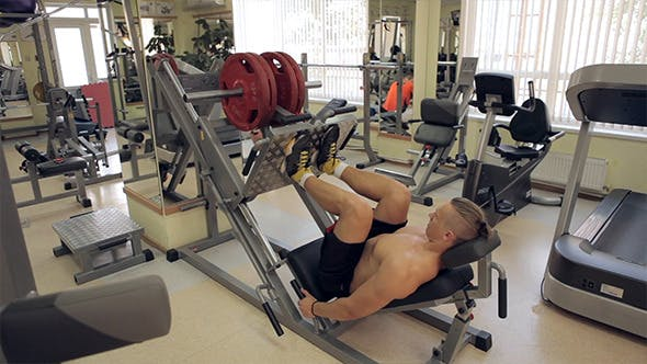 Thumbnail for Bodybuilder Pushing Weights With Legs