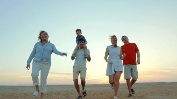 Thumbnail for Enjoable Family Walk On The Beach