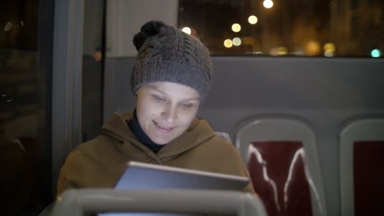 Thumbnail for Woman Chatting On Pad In The Bus