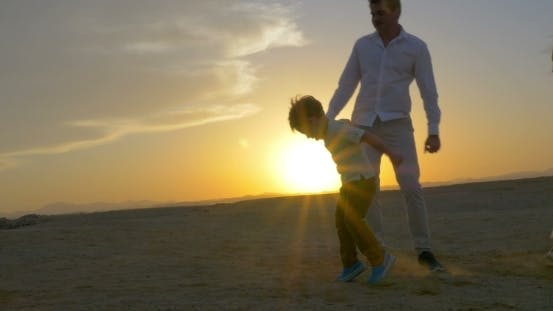 Thumbnail for Parents And Son Dancing At Sunset