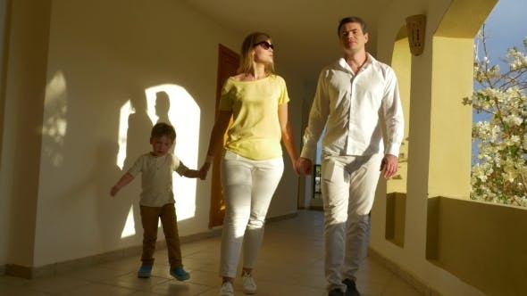 Thumbnail for Young Family Walking Over The Passage