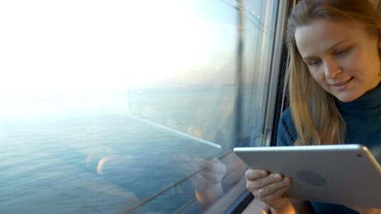 Thumbnail for Woman Traveling By Train And Using Tablet PC
