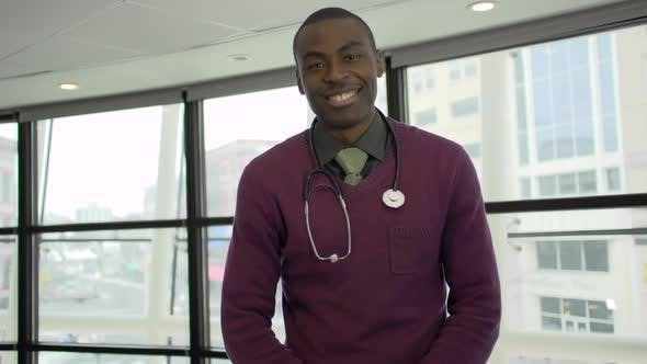 Thumbnail for A Black Male Medical Professional Walks Up To The Camera (1 Of 5)