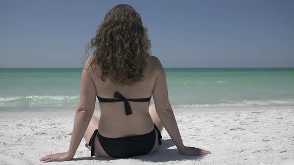 Thumbnail for Woman Relaxing On A Morning Beach  (2 Of 9)