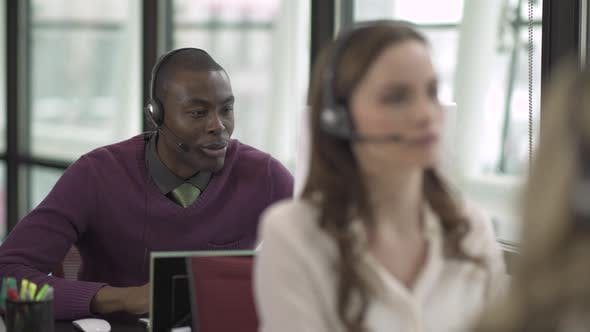 Thumbnail for A Black Man Works In A Attractive Modern Call Center (3 Of 4)