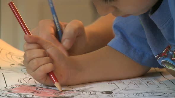Cover Image for Small Boy Drawing Pencil