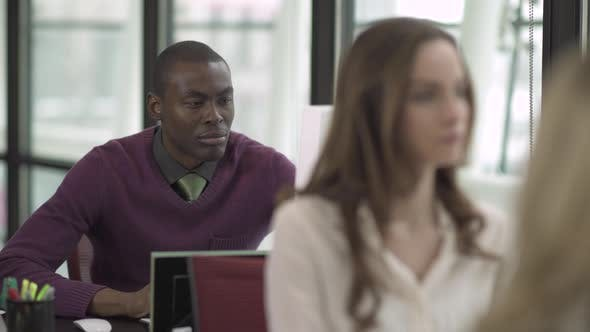 Thumbnail for A Black Man Works In A Attractive Modern Office (2 Of 2)