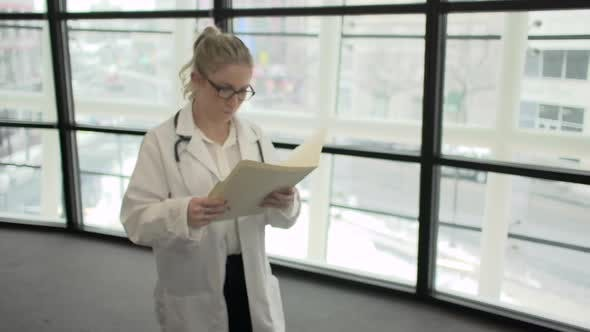 Thumbnail for A Blonde Caucasian Female Medical Professional Walks Up To The Camera (4 Of 4)