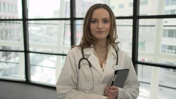 Thumbnail for A Caucasian Female Medical Professional Walks Up To The Camera (1 Of 9)