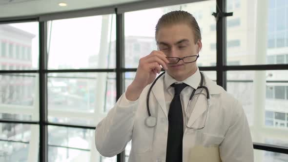Thumbnail for A Caucasian Male Medical Professional Walks Up To The Camera (1 Of 10)