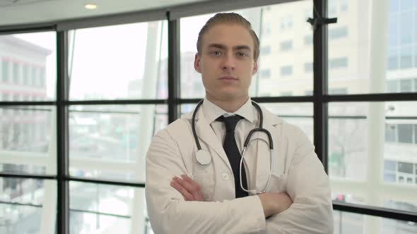 Thumbnail for A Caucasian Male Medical Professional Walks Up To The Camera (3 Of 10)